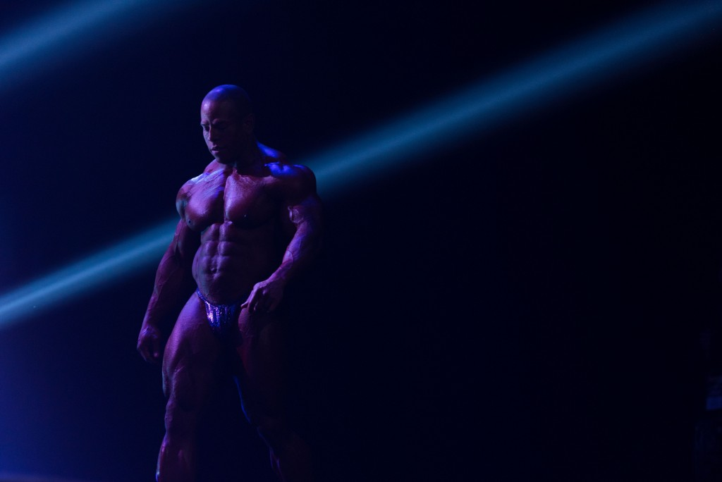 David Henry of South Hadley, Massachusetts, walks onto the stage at the Arnold Classic 212 on Saturday, March 4. (Nickolas Oatley/WOUB)