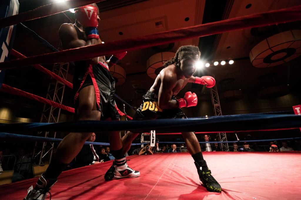 Antwan Jackson swings a punch at Mohamed Abdullah in the corner of the ring. (Nickolas Oatley/WOUB)