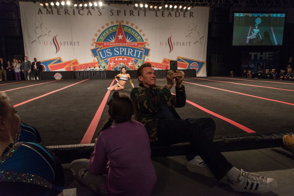 Arnold Schwarzenegger takes a selfie-video with the National Champion Cheerleader at the Cardinal Center in Columbus, Ohio.  (Nickolas Oatley/WOUB)