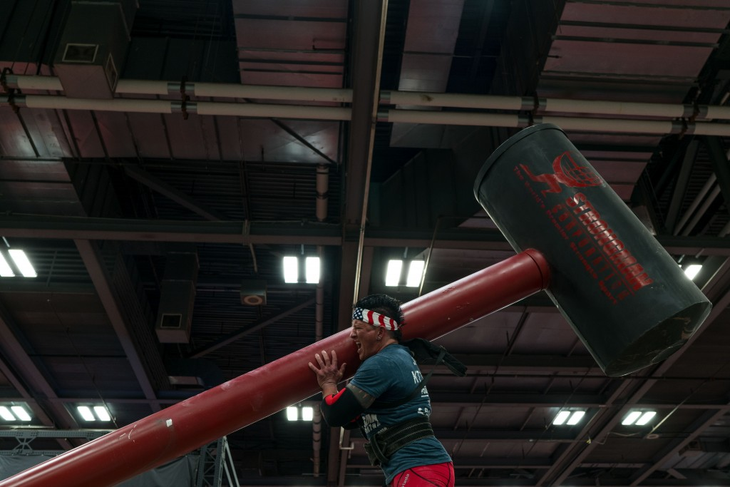 Kristin Johnson competes in lifting the hammer at the Women's Strongman. (Nickolas Oatley/WOUB)