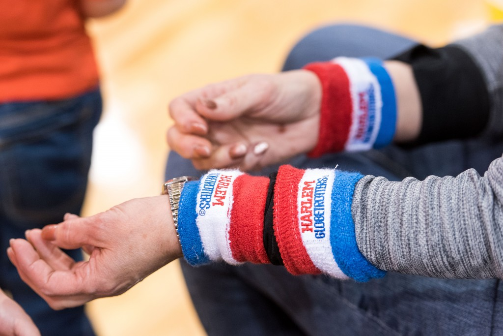 """Bonnie Sparks puts on her newly aquired Harlem Globetrotters sweatbands that were given to her by """"Bull"""" after he had taken her purse. (Nickolas Oatley/WOUB)"""