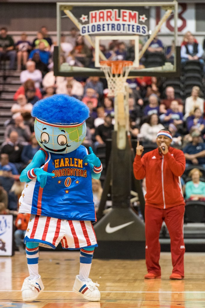 Harlem Globetrotters mascot, Globie, dances at half court to start of the show at the Big Sandy Superstore Arena in Huntington, WV on Wednesday, March 1st. (Nickolas Oatley/WOUB)