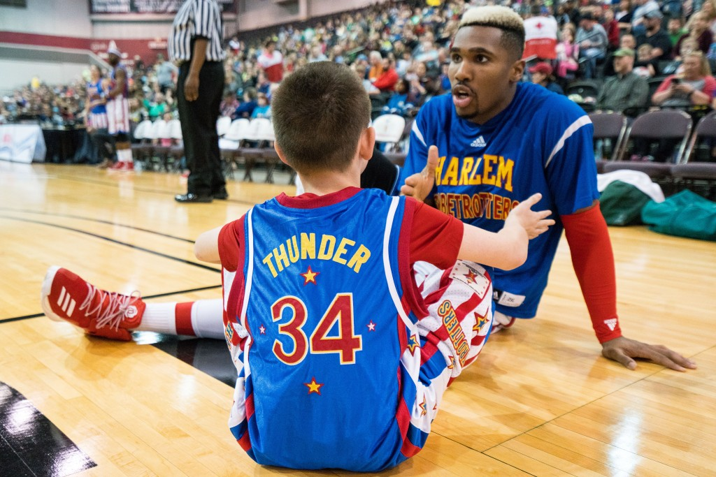 """""""Thunder"""" picks children from the crowd to participate in the fourth quarter of the game. (Nickolas Oatley/WOUB)"""