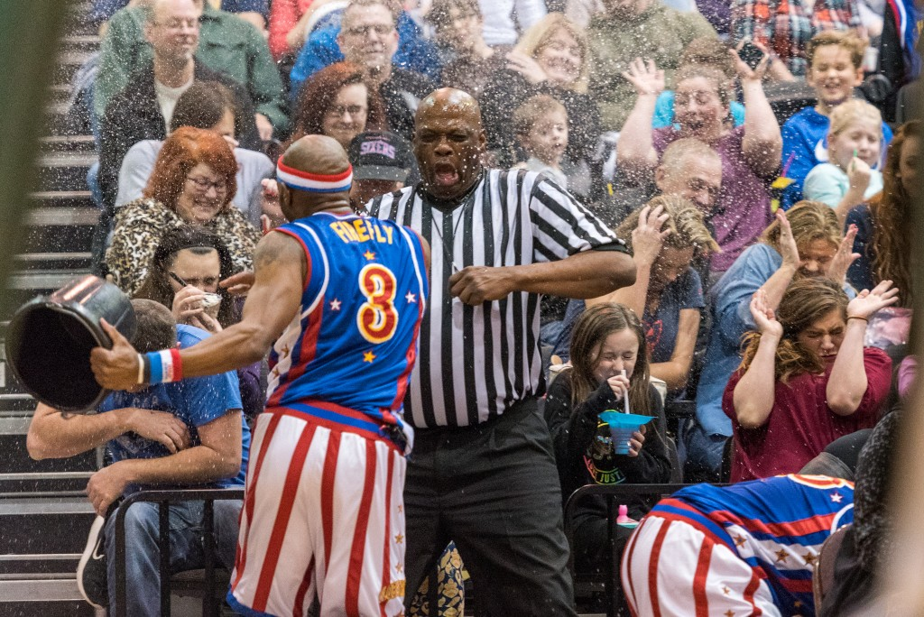 """""""Firefly"""" soaks a referee and crowd with a bucket of water after not having the call go his way. (Nickolas Oatley/WOUB)"""