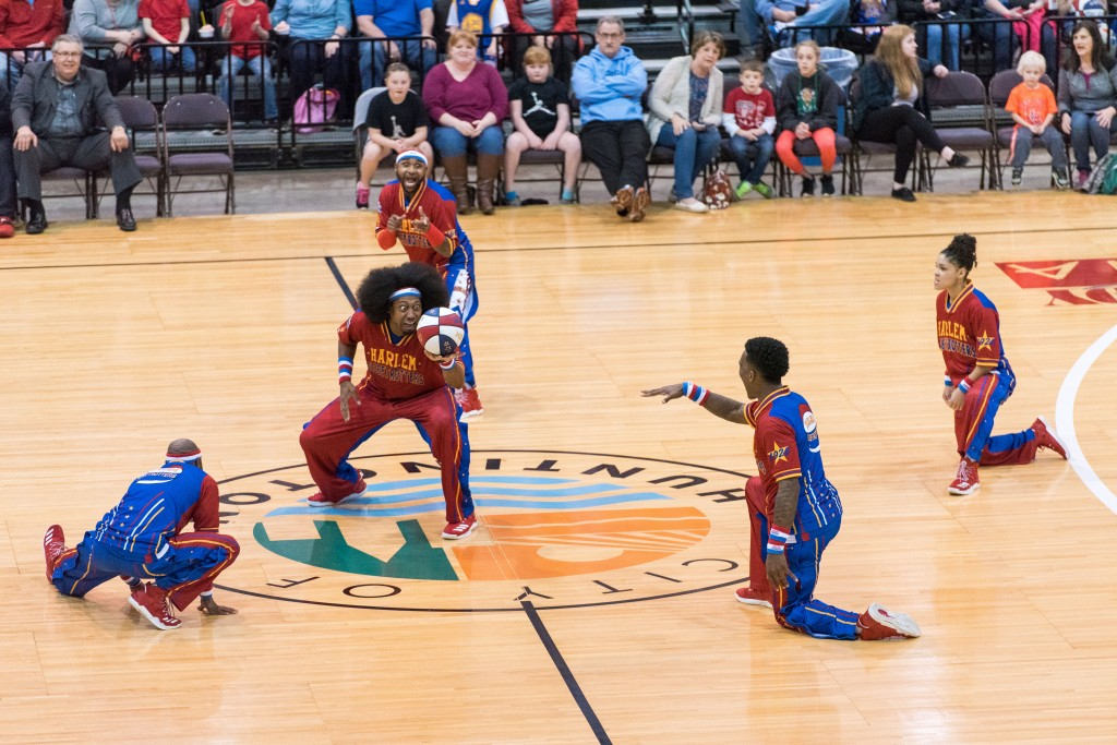 The Harlem Globetrotters pump up the crowd at center court by showing off their moves. (Nickolas Oatley/WOUB)