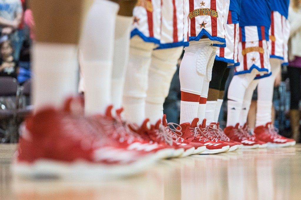 The Harlem Globetrotters stand together during the National Anthem. (Nickolas Oatley/WOUB)