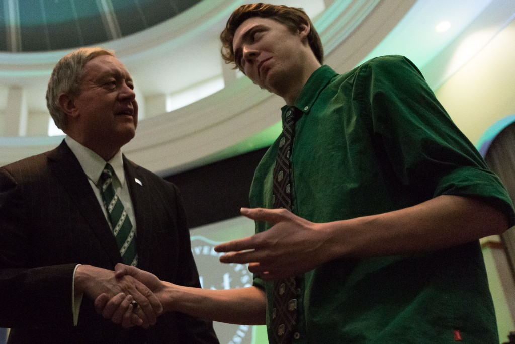 """Ohio University student Quentin Reams, Junior in Pre Law, asks newly appointed President Duane Nellis, """"Are you excited for Mill Fest this weekend?"""". Nellis replied, """"I don't know if we will be able to make it tonight we are heading home for the weekend."""" (Nickolas Oatley/WOUB)"""
