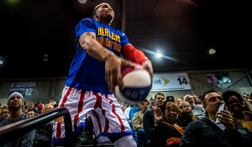 Harlem Globetrotter, Thunder, throwing the ball at the basket from the stands before the game against the World All-Stars at the  Harlem Globetrotters game in the Big Sandy Superstore Arena, in Huntington, West Virginia, on March 1, 2017. (Carolyn Rogers/WOUB)