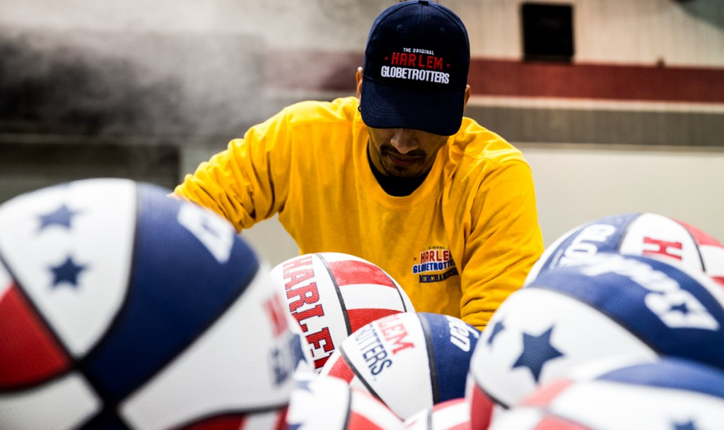 A worker posing for a portoirt before handing out basketballs during the  Harlem Globetrotters game in the Big Sandy Superstore Arena, in Huntington, West Virginia, on March 1, 2017. (Carolyn Rogers/WOUB)
