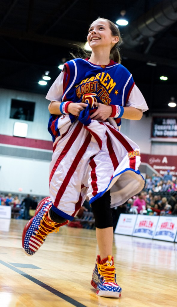 A Harlem Globetrotters fan running to the finish line after competing in a relay before the game started at Big Sandy Superstore Arena, in Huntington, West Virginia, on March 1, 2017. (Carolyn Rogers/WOUB)