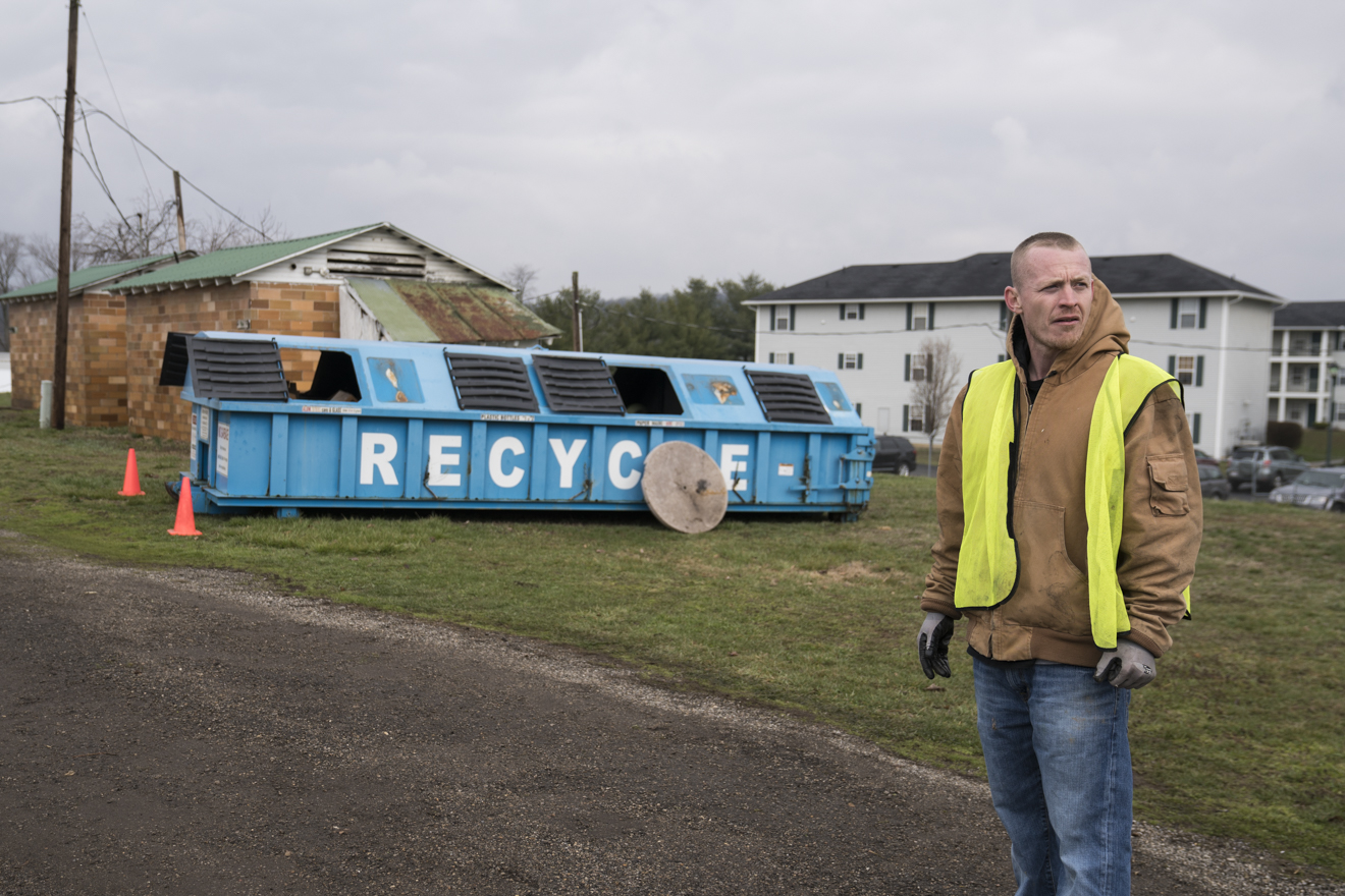 A volunteer from SEPTA Correctional Facility at the Recycle Mania event held at the Athens County Fair Grounds directs traffic toward the scrap metal section and tire drop off.