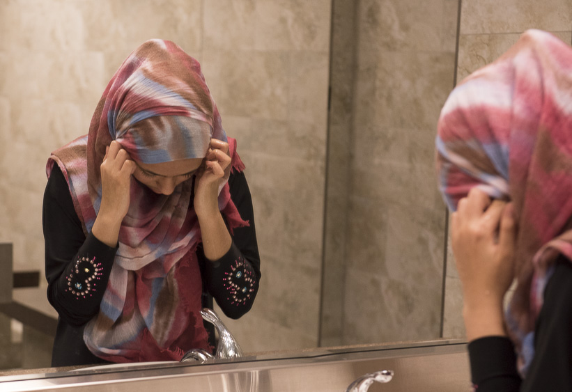 A young girl washes her face, hands and feet at the Abubakar Asiddiq Center in Columbus, Ohio on March 18, 2017. It is apart of Islamic custom to be cleanly all over your body before praying, which they do five times a day. (Camille Fine/WOUB)