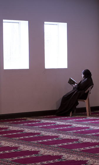 A women reads in the women's prayer room at the Abubakar Asiddiq Center in Columbus, Ohio on March 18, 2017.