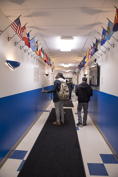 Ohio University students walk around the Focus Learning Academy of Northern Columbus on March 18, 2017. Focus Learning Acadamy is a K-8 charter school for Somali immigrant children. (Camille Fine/WOUB)