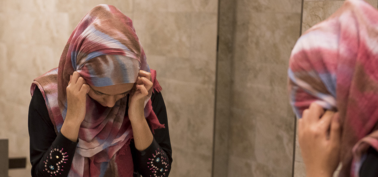 A young girl washes her face, hands and feet at the Abubakar Asiddiq Center in Columbus, Ohio on March 18, 2017. It is apart of Islamic custom to be clean all over your body before praying, which they do five times a day. (Camille Fine/WOUB)