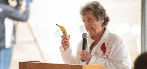 Rhoda Price holds a banana as she speaks at the Campbell's Market groundbreaking ceremony in Vinton County on March 20.  (Robert Green/WOUB)