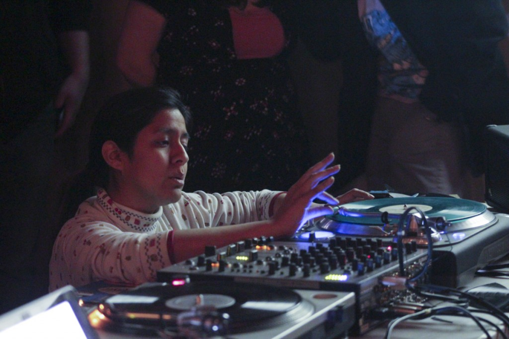 Sound artist Maria Chavez demonstrates a sound art technique on one of her turntables. (Marie Swartz/WOUB)