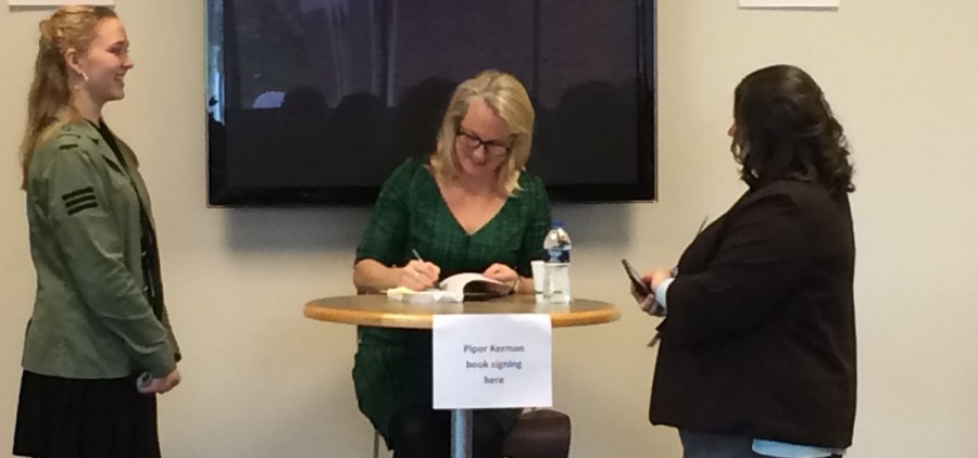 Author Piper Kerman signs a fan's book. Kerman was the keynote speaker for Ohio University Lancaster's 11th annual Celebrate Women Conference. (Emily Votaw/WOUB)