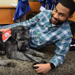 Robert Spivey says he and his service dog in-training, Peeves, have built a strong bond.