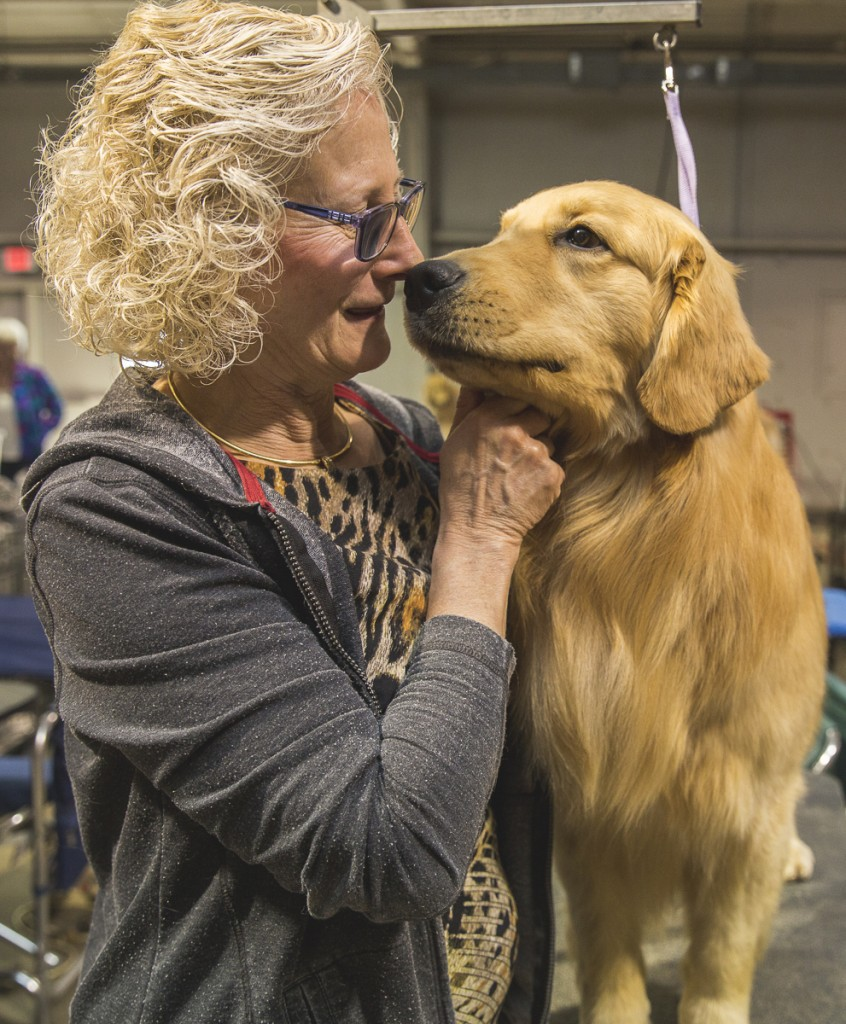 Ruth Parker, of Columbus, Ohio, spends a moment with her Golden Retriever at the Central Ohio Kennel Club in Columbus, Ohio. (Erin Clark/ WOUB)