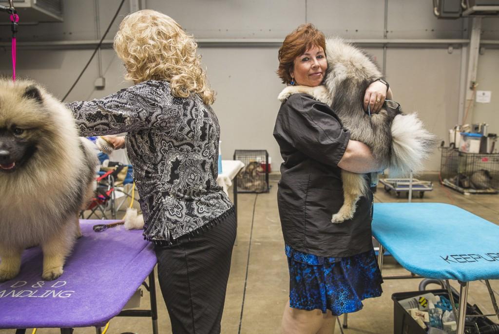 Alecia Novak, of Windsor, Ontario, Canada poses with Keeshond, Taiga. (Erin Clark/WOUB)