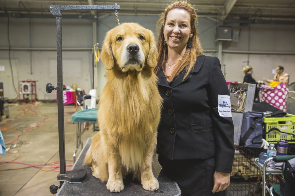Megan McClung, of Albany, Ohio, poses with golden retriever, Luke. McClung was awarded as the number one owner handled golden retriever in the country. (Erin Clark/WOUB)