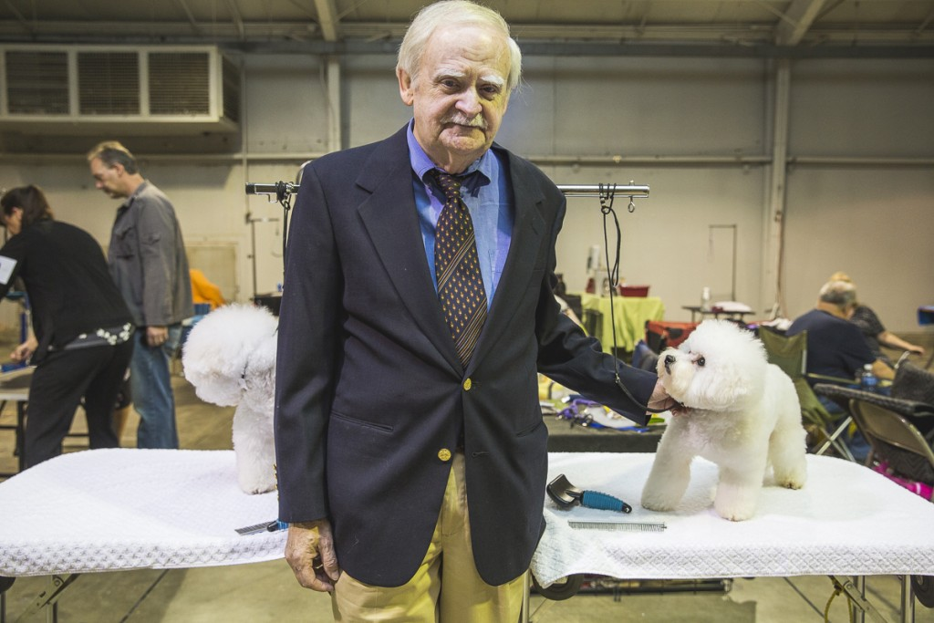 Pat Dolan, of Summer County, Ohio, poses with Dylan (left) and Cooper (right), both Bichon-Frises. Dolan has been showing dogs for over 20 years. (Erin Clark/WOUB)