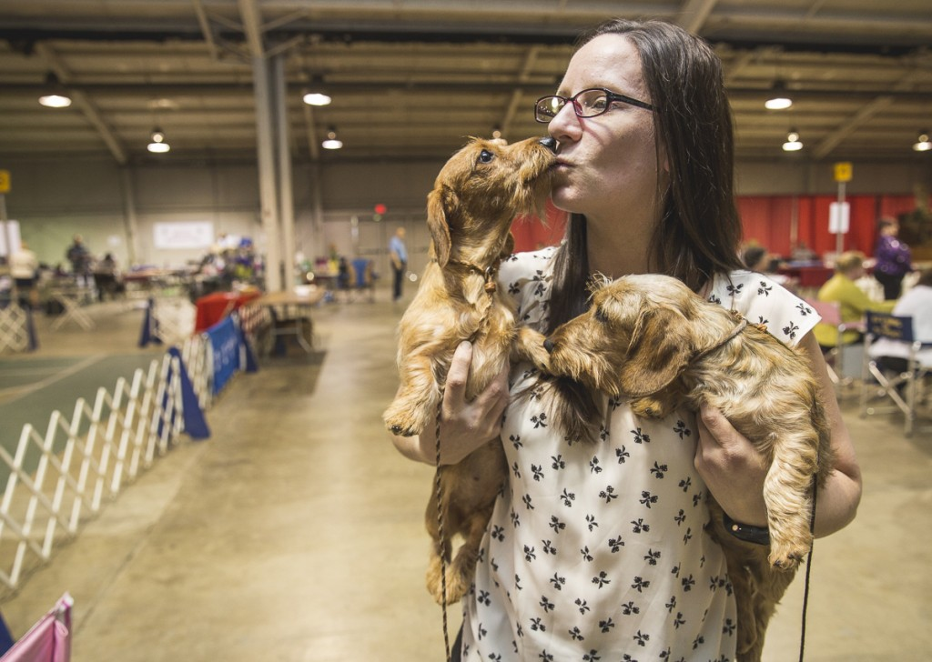 Kari Dannmiller, of Cleveland, Ohio, poses with her wire-haired dauchshunds, Flip and Oo-lah. (Erin Clark/WOUB)