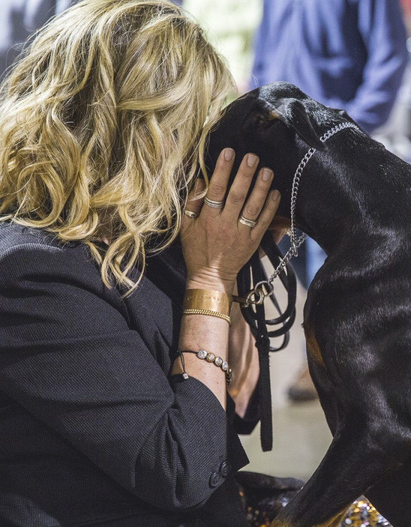 Lisa Sangregorio, of Youngstown, Ohio, embraces her two-year-old doberman. Sangregorio has been showing dogs for six years. (Erin Clark/WOUB)