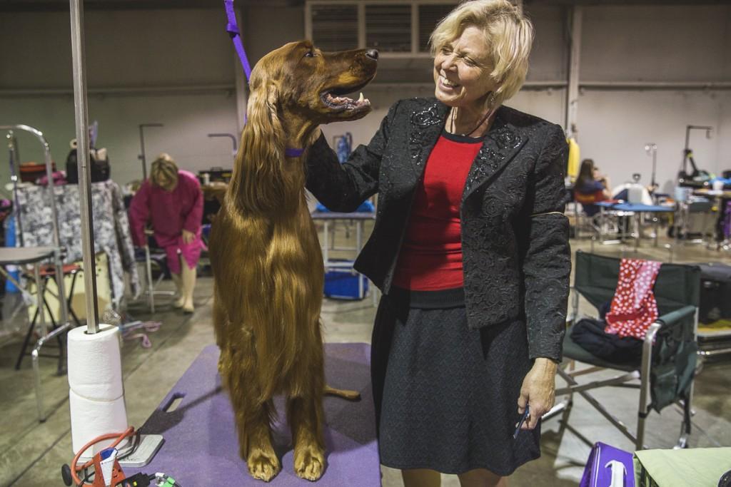 Bobbi Fisher, Dover, Ohio, poses with her three year old Irish Setter, Diamond. Diamond is Bronze Grand Champion. (Erin Clark/WOUB)
