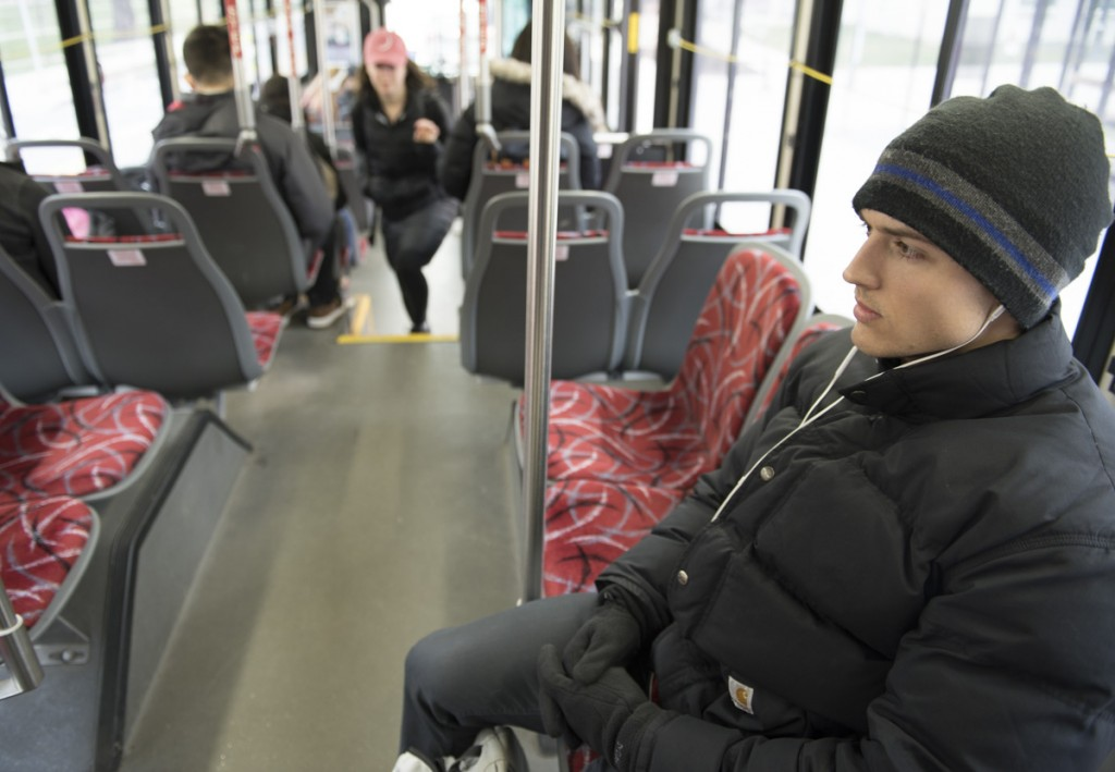 Even though Nick is a competitive bodybuilder, he is also a normal student who rides the bus many mornings to class at Ohio State University like many other students. (Robert McGraw/WOUB)