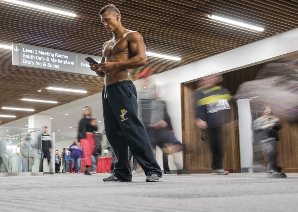 After the athlete's meeting for the 2017 Arnold Sports Festival Amateur Men's Physique competitors, Nick takes one last glance at his meal schedule as people fill the Columbus Convention Center for the numerous events of the day. (Robert McGraw/WOUB)
