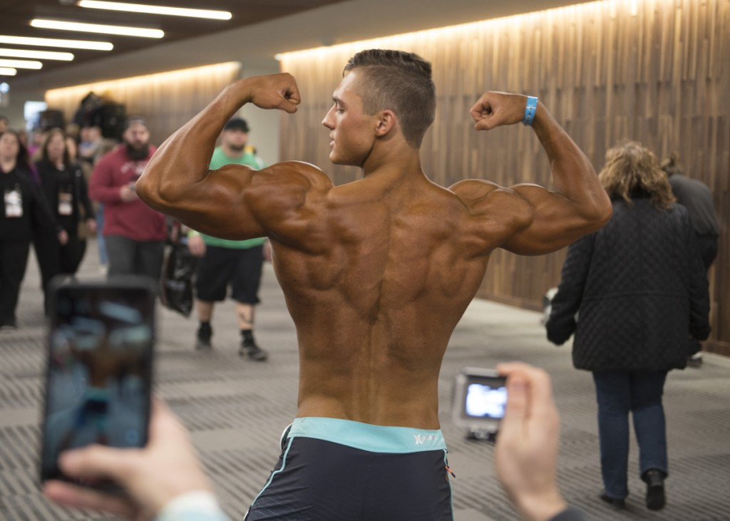 Bodybuilding fans take pictures of Nick after his preliminary physique judging. (Robert McGraw/WOUB)