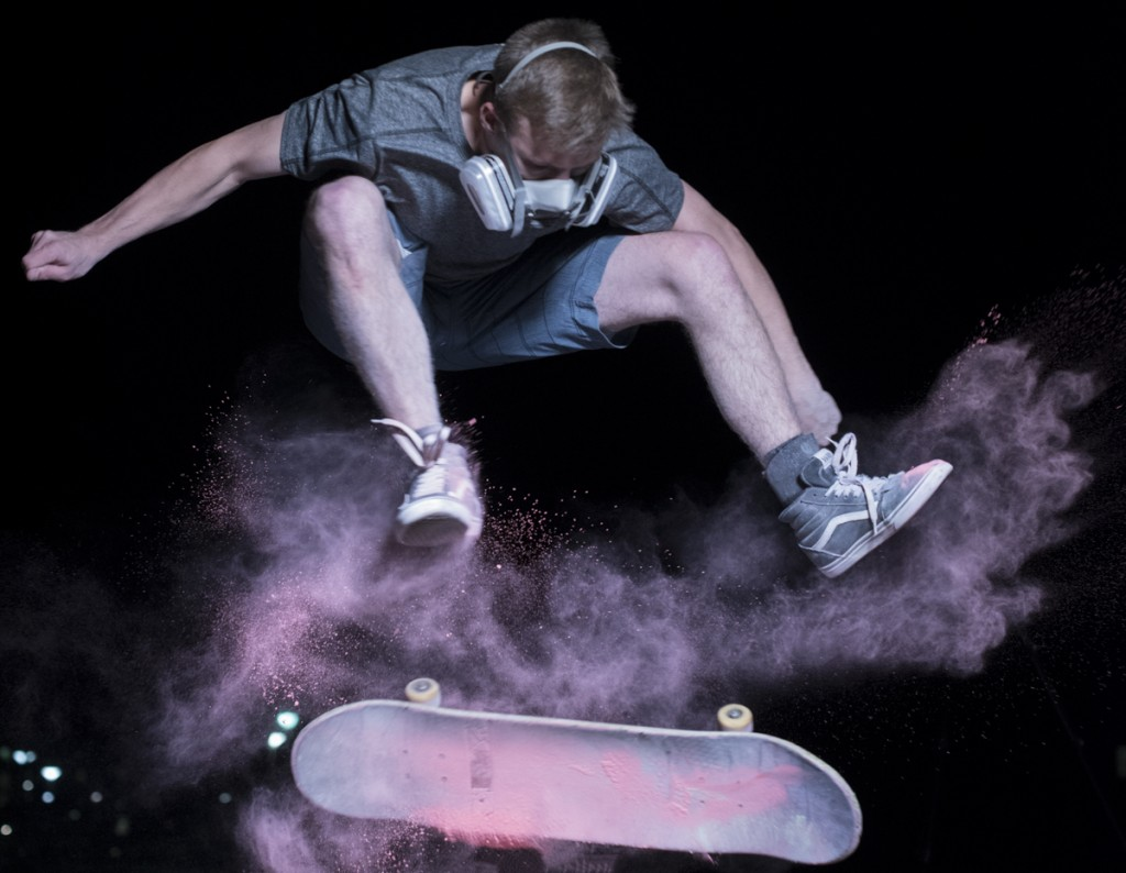 Kyle Boyher skating with chalk powder in Athens Ohio on March 30, 2017.  (Robert Green/WOUB)