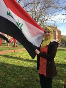 Ahajir Ali holding the Iraq Flag on College Green