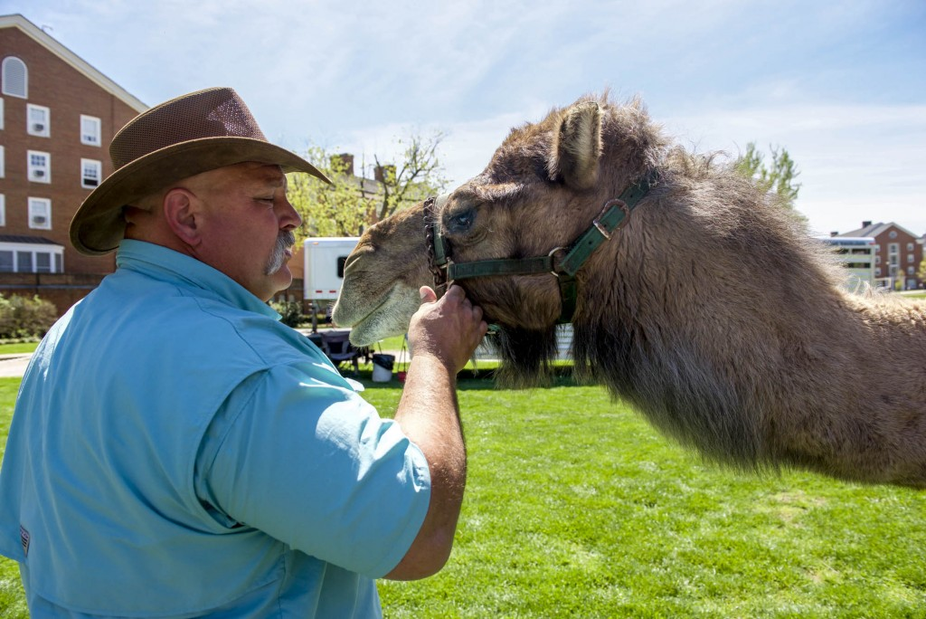 Don Stroble talks to Gunner as he takes a rest at the Zoo To You Event on Tuesday, April 18, 2017. (Daniel Linhart/WOUB)