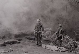 Long Khanh Province, Republic of Vietnam....SP4 R. Richter, 4th Battalion, 503rd Infantry, 173rd Airborne Brigade, lifts his battle weary eyes to the heavens, as if to ask why? Sergeant Daniel E. Spencer stares down at their fallen comrade. The day's battle ended, the silently await the helicopter which will evacuate their comrade from the jungle covered hills.
