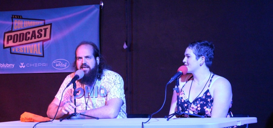 Nick Glaser gets down to the nitty-gritty with one of his guests on his FartCast at the Columbus Podcast Festival. (WOUB/Emily Votaw)