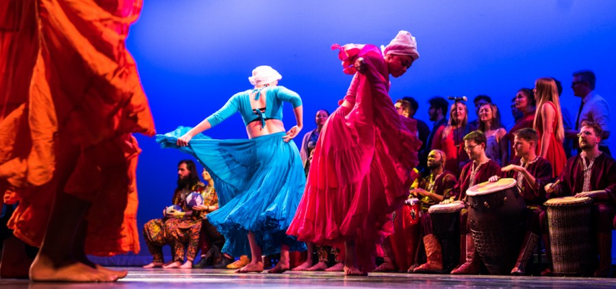 Dancers perform during Gede Nibo, a traditional Haitian religious chant that is a sacred song for the spirit of the departed and cemeteries arranged for mixed  voices and percussions, at the Global Excursions Concert in Templeton-Blackburn Alumni Memorial Auditorium on March 31, 2017. (Carolyn Rogers/ WOUB)