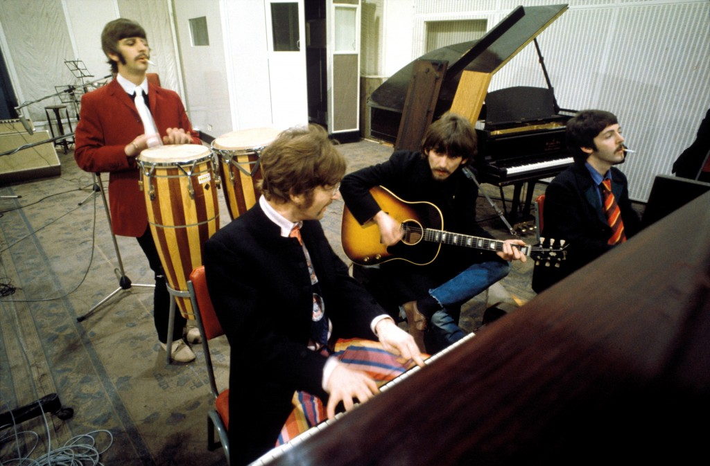 "A photo of The Beatles during the recording of ""Sgt. Pepper's"" in January 1967. (Courtesy of Apple Corps Ltd.)"