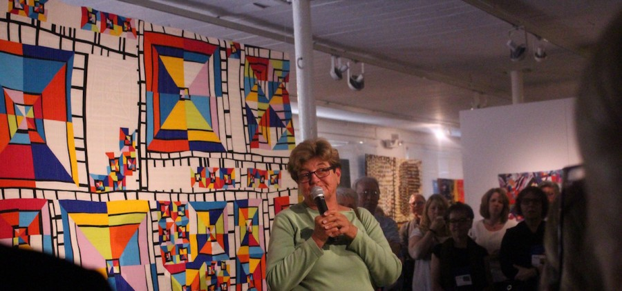 World-renowned quilter Nancy Crow announces winners at the May 26 Quilt National opening. (WOUB/Emily Votaw)