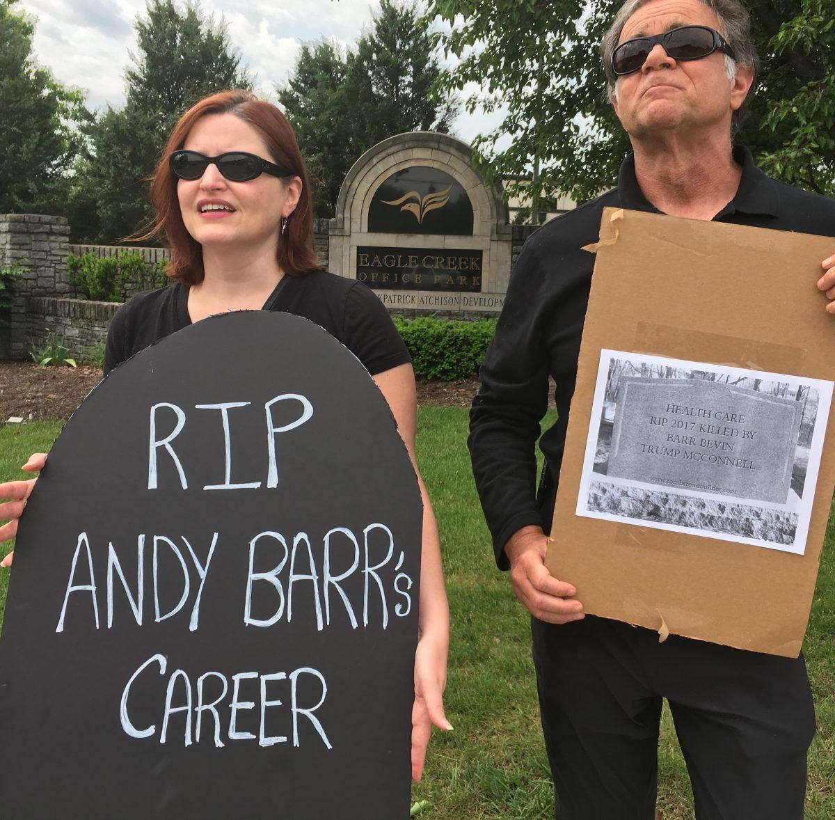 Susan Wheeler Ferguson and Matt Simpson protest the AHCA in Lexington, Ky. (Mary Meehan/ Ohio Valley ReSource)