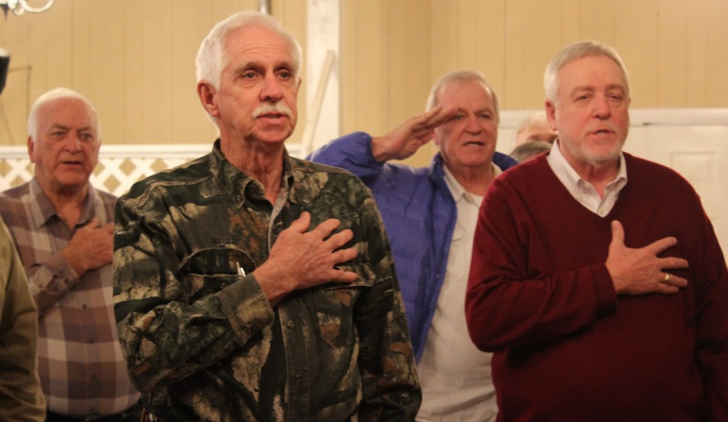 Retired miners begin a meeting with the pledge of allegiance. (Becca Schimmel/ Ohio Valley ReSource)