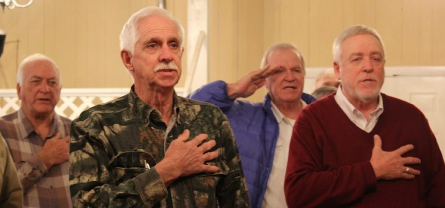 Retired miners begin a meeting with the pledge of allegiance.