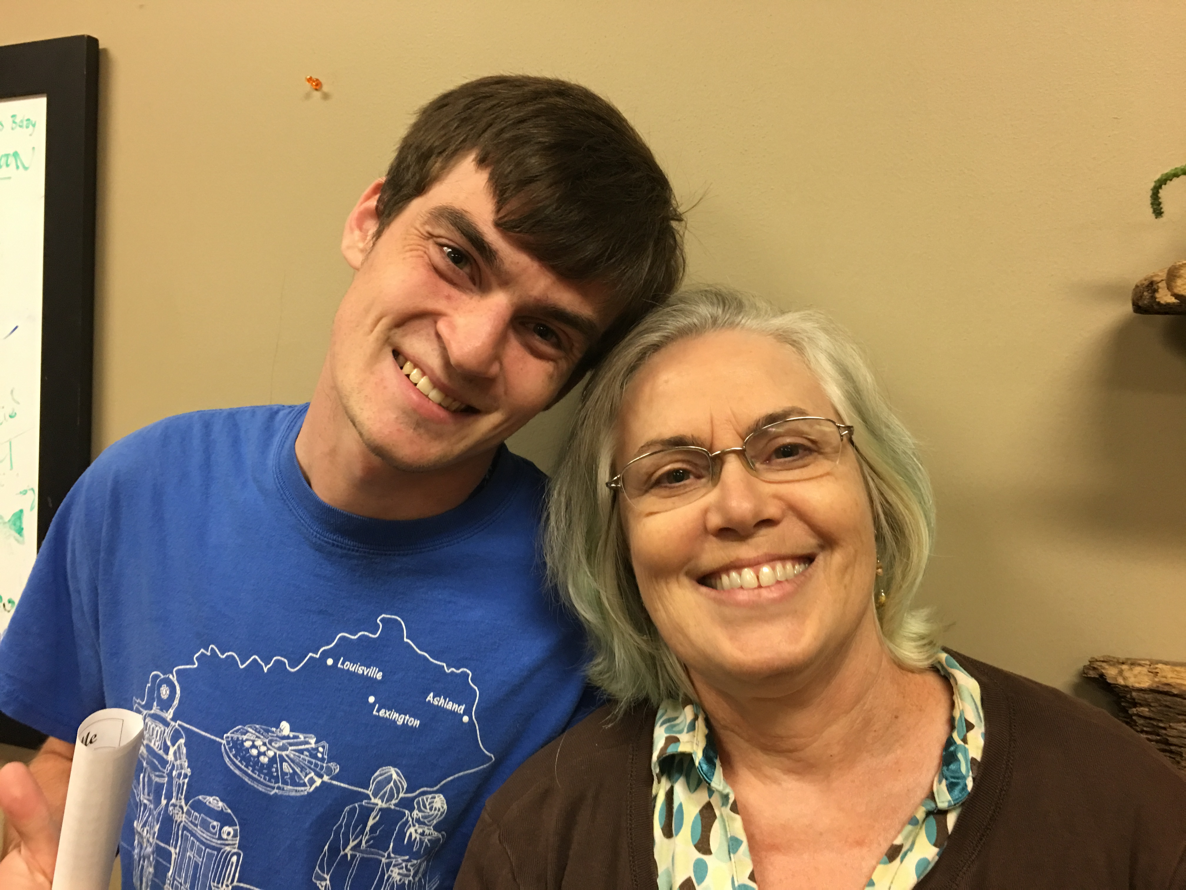 Jake Parsons with his mother at a strategy meeting to fight Medicaid cuts.