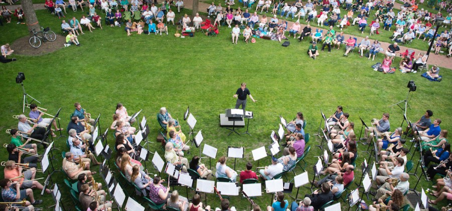 Ohio University School of Music Director of Band Andrew Trachsel directs musicians involved in the Communiversity band performing during an Under the Elms concert. (Submitted)