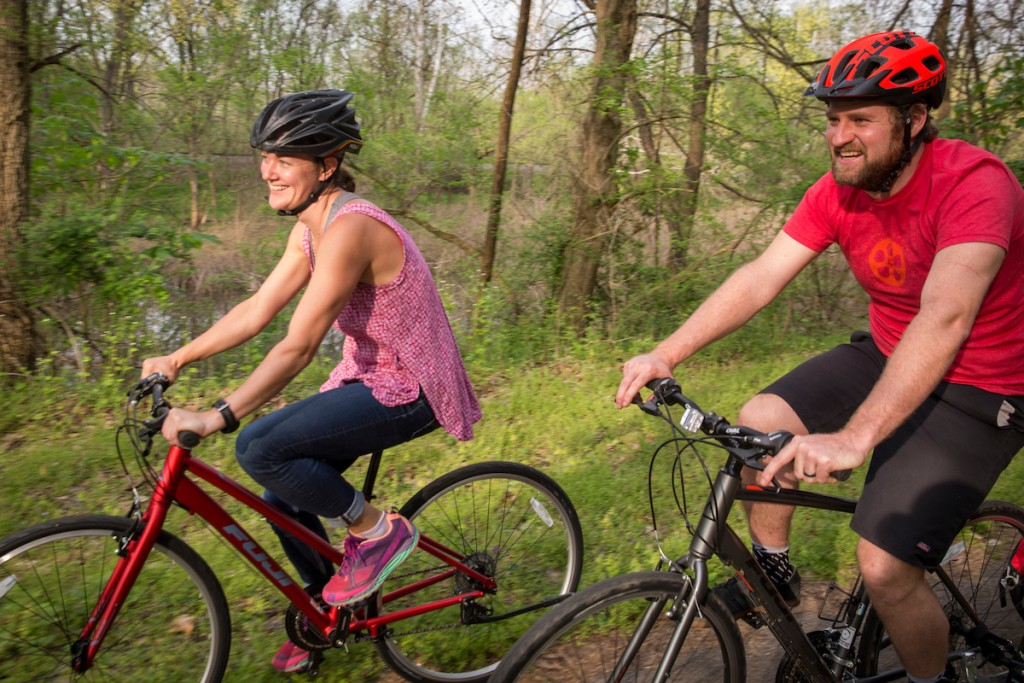 Vince and Timarie of Black Diamond Bicycles on the Hockhocking Adena Bikeway near the Eclipse Company Town in The Plains. (Photograph by Joel Prince)