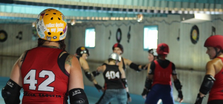Members of the Appalachian Hell Betties practice at Dow's Roller Arena outside of Nelsonville. (WOUB/Emily Votaw)