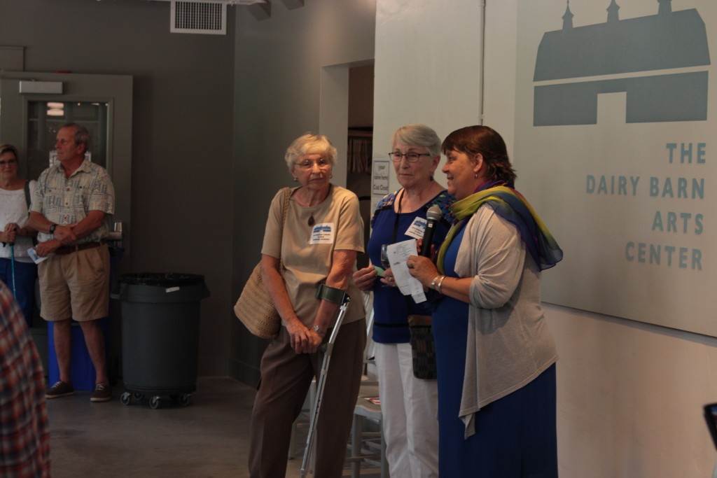 The daughters of Ora Anderson with Dairy Barn Arts Center Executive Director Jane Forrest Redfern. (WOUB/Emily Votaw)