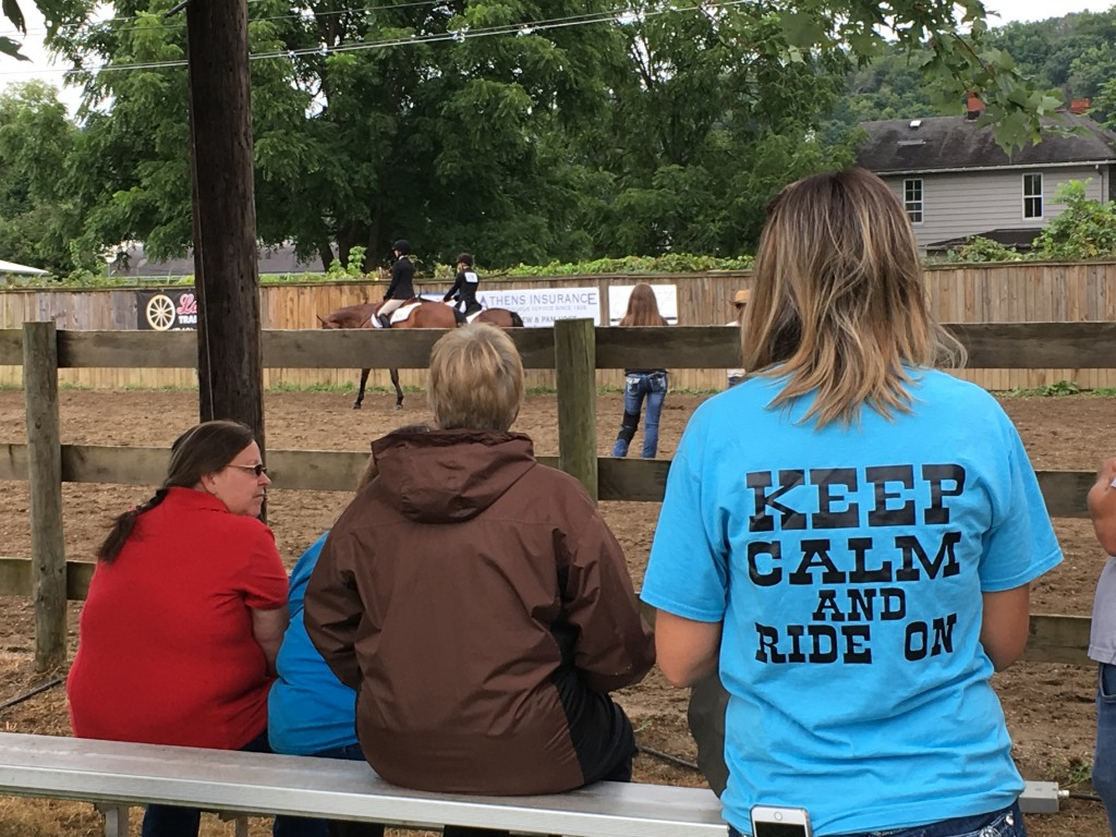Visitors to the Athens County Fair watch the English portion of the horse competition.  Photo by Susan Tebben / WOUB News